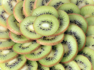 fresh ripe kiwi fruit cut into slices as part of a treat