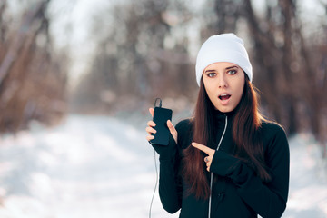 Winter Smartphone Girl Listening to Music Radio Using Earphones