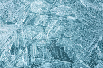 Frozen river surface covered with ice, macro view. Natural winter texture background