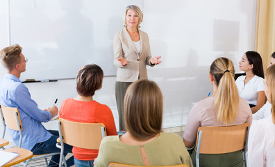 Female teacher lecturing to students