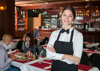 Young waitress meeting guests