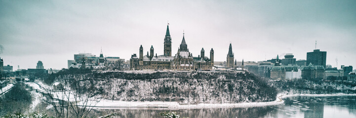 Ottawa Parliament in Winter . Cityscape of Canada's capital city, canadian travel destination in snow landscape. Banner panorama.