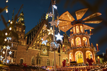 Christmas fair in the market square of Wroclaw, Poland. The city hall and wind mill.