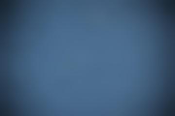minimalistic blurred dark blue background with vignette
