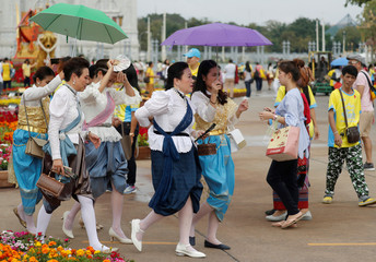 """Women in traditional clothes attend the """"Un Ai Rak Khlai Khwam Nao or Love and Warmth at Winter's End"""" festival in Bangkok"""