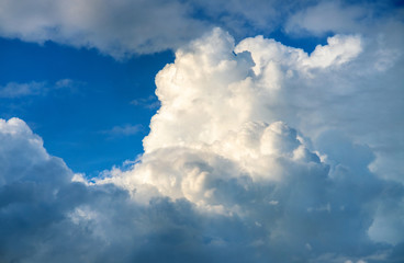 Blue sky and white cloud in sunlight. Cloudscape photo background. Romantic skyscape with fluffy cloud.