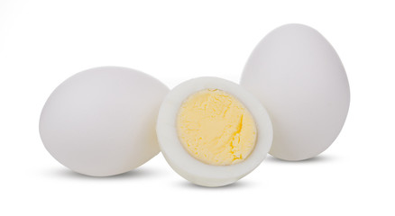 Two boiled whole and sliced eggs isolated on white background