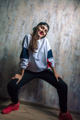 stylish female street dancer posing to the camera. free time, people, youth, culture concept. close up photo