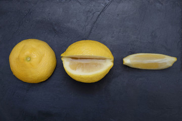 whole and sliced natural lemon