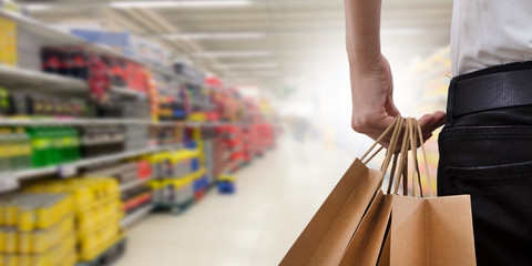 hand with shopping bags in the supermarket