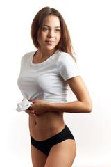 slim body of a charming model. close up shot. studio shot. isolated white background.