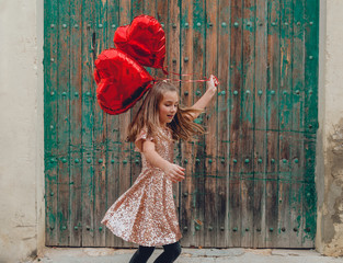 girl dancing with red balloons