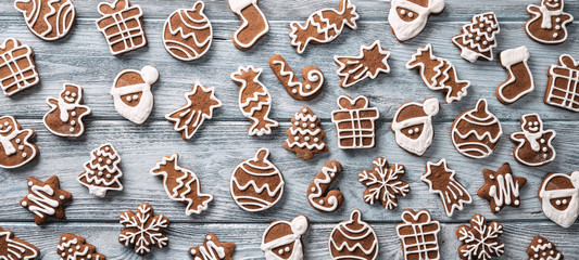 Panoramic view of many gingerbread cookies on the wooden table