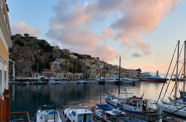 Symi Island, Greece - 9 September , 2017 : Symi Island Harbour with the amazing pink sunrise