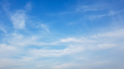 Deep blue sky and white cloud background.