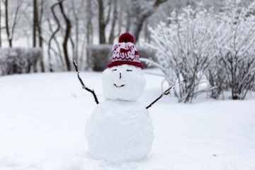 Winter mood: Small simplistict snowman in Christmas hat