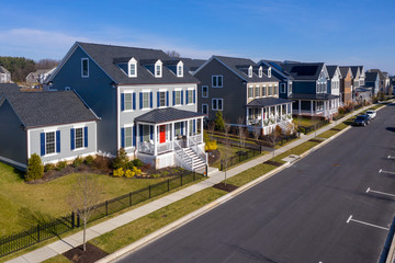 Aerial view of typical american colonial single family luxury home real estate neighborhood street for upper middle class families in the USA