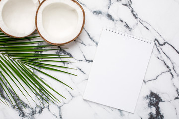 Tropical coconut , palm tree and notebook on marble background