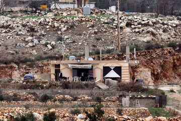 A general view shows what seems to be a restaurant by the border line between Israel and Lebanon, as it is seen from the Israeli side of the border