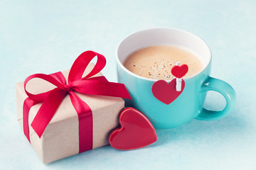 Gift box, cup of coffee and hearts for Valentines day breakfast.