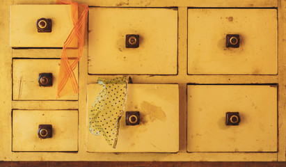 Vintage drawer with decorative ribbons