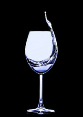 Splashing from a glass of wine on a solid background