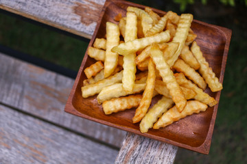 Zoom French Fries in cup on wood