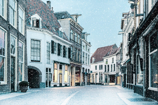 Shopping street with snowfall in the Dutch city center of Zutphen