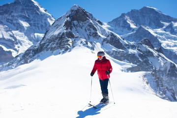Ski and snow fun. Man skiing in mountains.