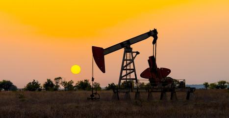 oil derrick pumping crude