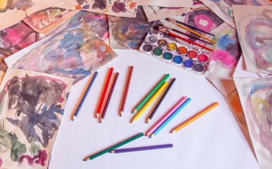 Colorful pencils on the desk. White background. Like rainbow. Colorful paintings on the desk.