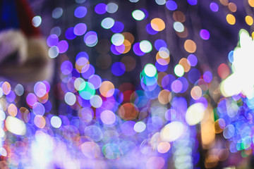 blurred christmas holidays background. Festive fair and colorful lights.