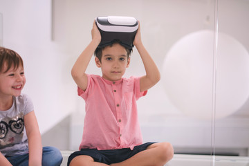 kids using virtual reality headsets at home