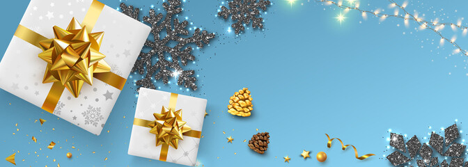 Merry Christmas and Happy New Year banner with top view gifts and snowflakes.