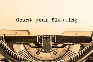Count your Blessing printed on a piece of paper on a vintage typewriter. writer, essay, journalism.