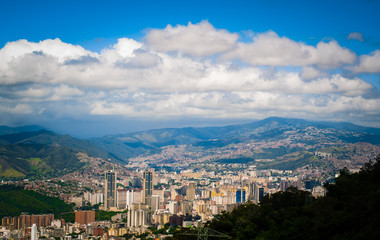 above view of Caracas city in Venezuela from Avila mountain during sunny cloudy summer day
