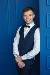 Stylish young man in a business suit