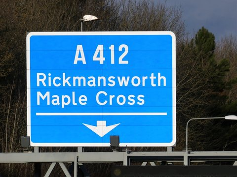 M25 exit sign at Junction 17 for Rickmansworth and Maple Cross A412