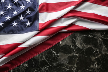 American flag on marble background, top view. Space for text