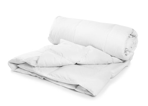 Rolled clean blanket on white background. Household textile