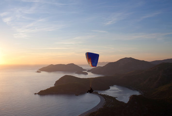 Paraglider flying at sunset over Blue lagoon in Oludeniz, Turkey