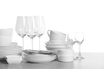 Set of clean dishes on white background