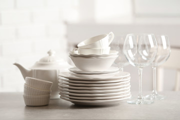 Set of clean dishes against blurred background