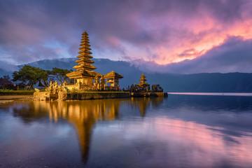 Ancient Pura Ulun Danu Bratan temple reflection with colorful sky at sunrise