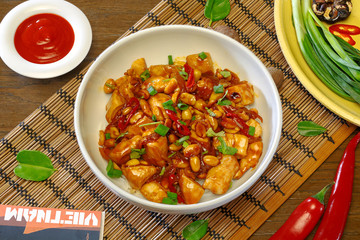 Chinese dish of chicken and rice on a plate, top view