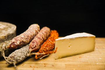 Variety of french dried sausages and cheese from Auvergne
