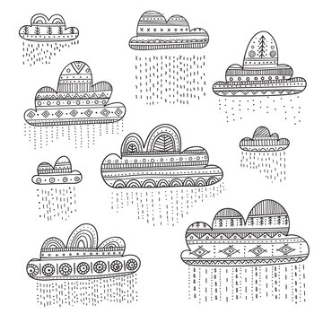 Lovely vector set with rainy clouds in Boho style with ornament.