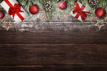 Frosty Christmas decorations and gifts on wooden desk. Christmas background with free space for text