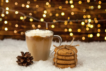 Cup of coffee and American cookies on winter Christmas background