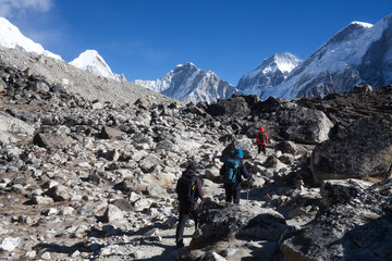 Unidentified tourists walking on the road to Everest Base camp, Nepal